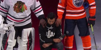 Minnesota Wild defenseman takes a knee during the American National Anthem