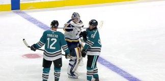 Jordan Binnington fakes a blocker punch on Erik Karlsson