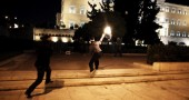 A protester throws a molotov cocktail at