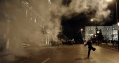 Demonstrators clash with riot police in