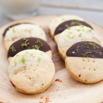 Sweet and Spicy Shortbread Cookies - crumbly, melt in your mouth shortbread cookies are flavoured with spicy cayenne pepper and zesty lime, then dipped in chocolate for extra indulgence. These easy to make chocolate dipped chili lime shortbread cookies are sure to satisfy everyone!