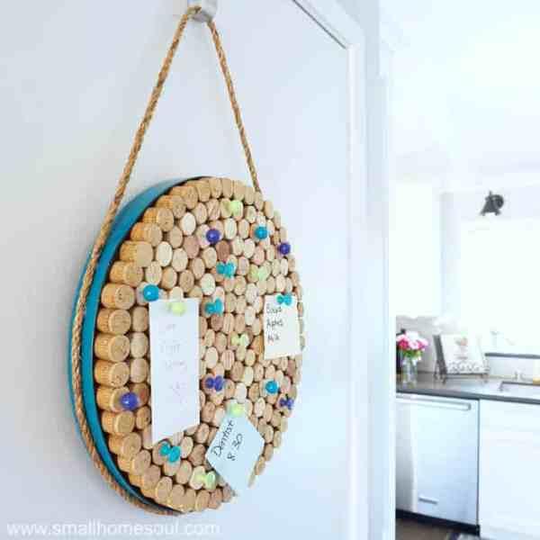 Completed wine cork board hanging on utility door.