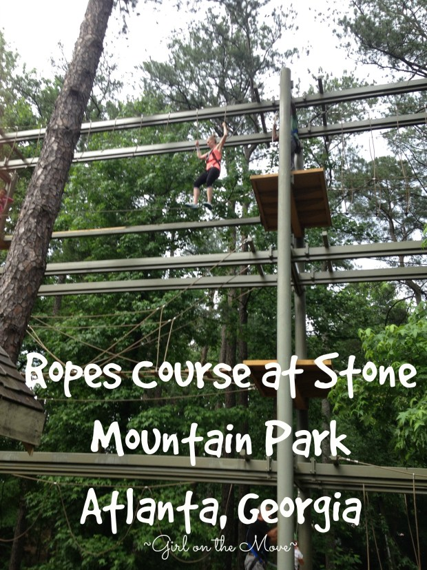 Climbing through the trees of the Ropes Course at Stone Mountain Park in Atlanta