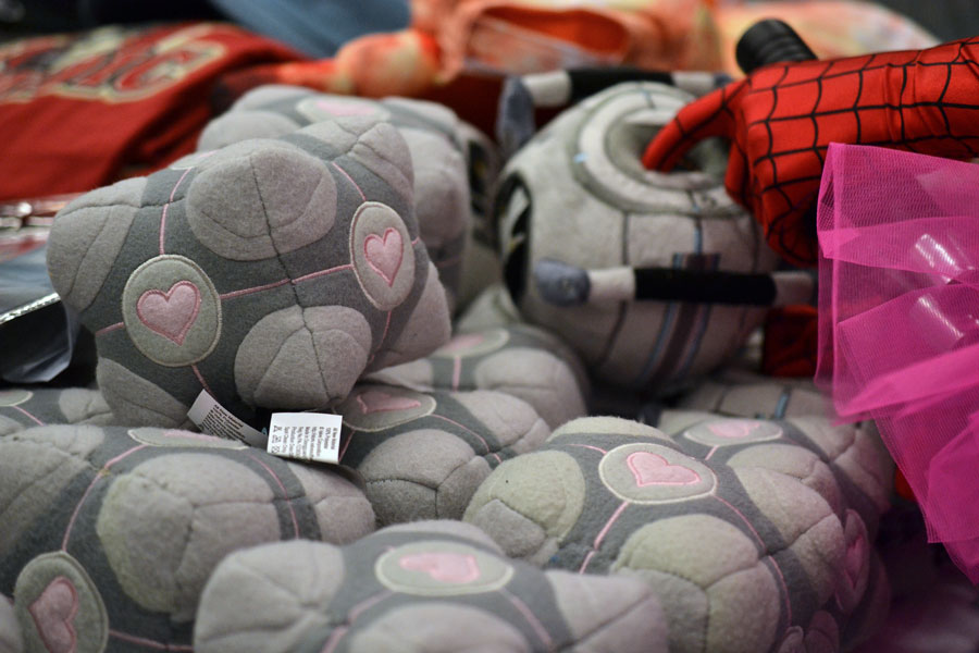 Companion cube plushies on sale at a vendor booth © Girls on Games / Catherine Smith-Desbiens