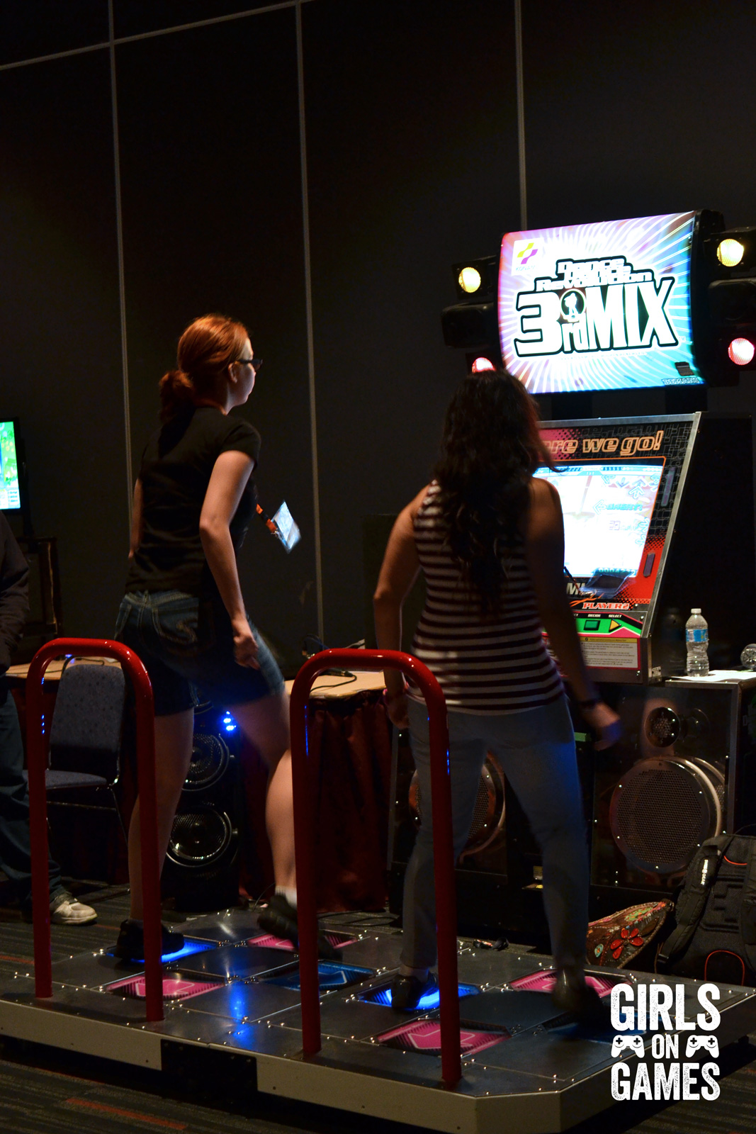 Otakuthon 2015 attendees play Dance Dance Revolution in the video game room.