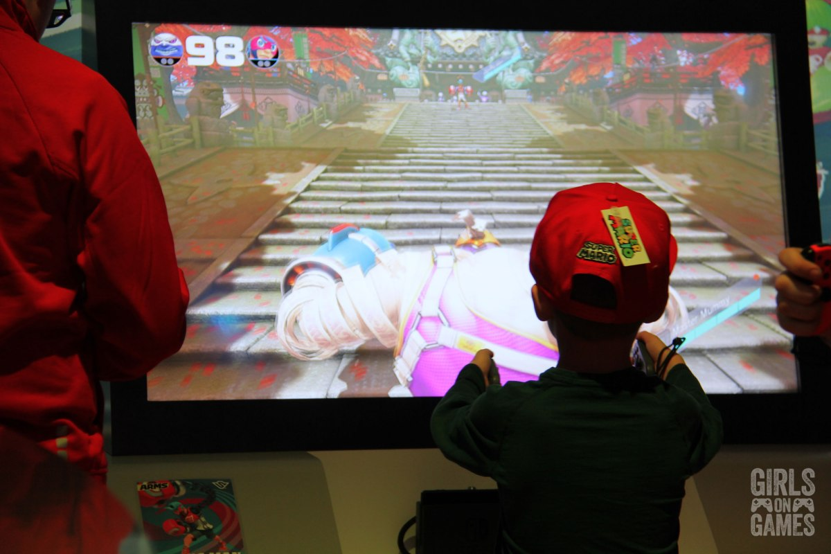 A kid enjoying playing Arms at the Nintendo Switch event in Toronto. Photo: Leah Jewer / Girls on Games