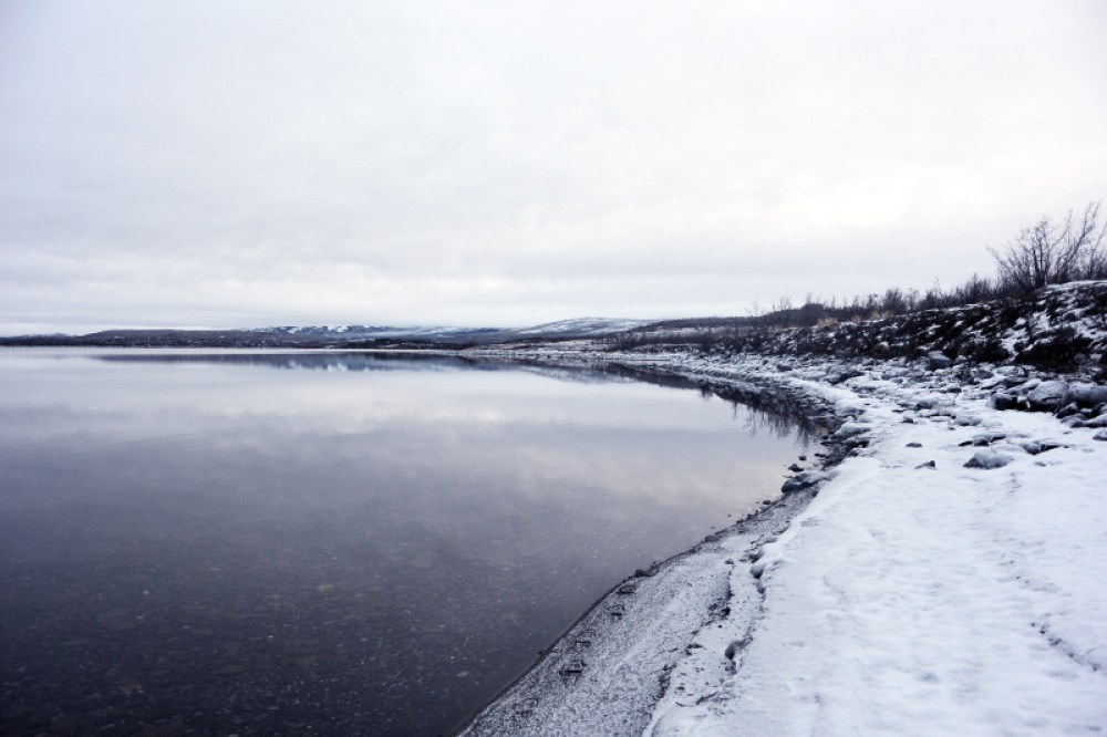 views over snow covered lake, sweden
