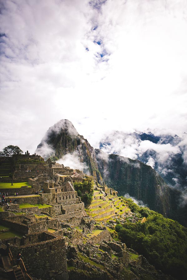 Travel Photography Tips for Non-Photographers: Image of Machu Picchu emerging from early morning clouds and mist.