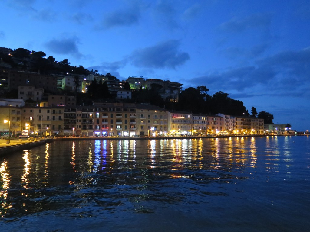 Night Time view of Monte Argentario over lake