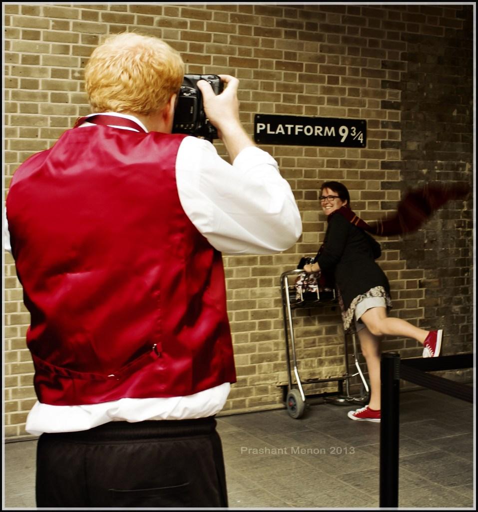 Girl posing for photo at platform 9 3/4