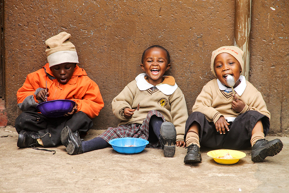 Kids having fun during lunch break in Kenya