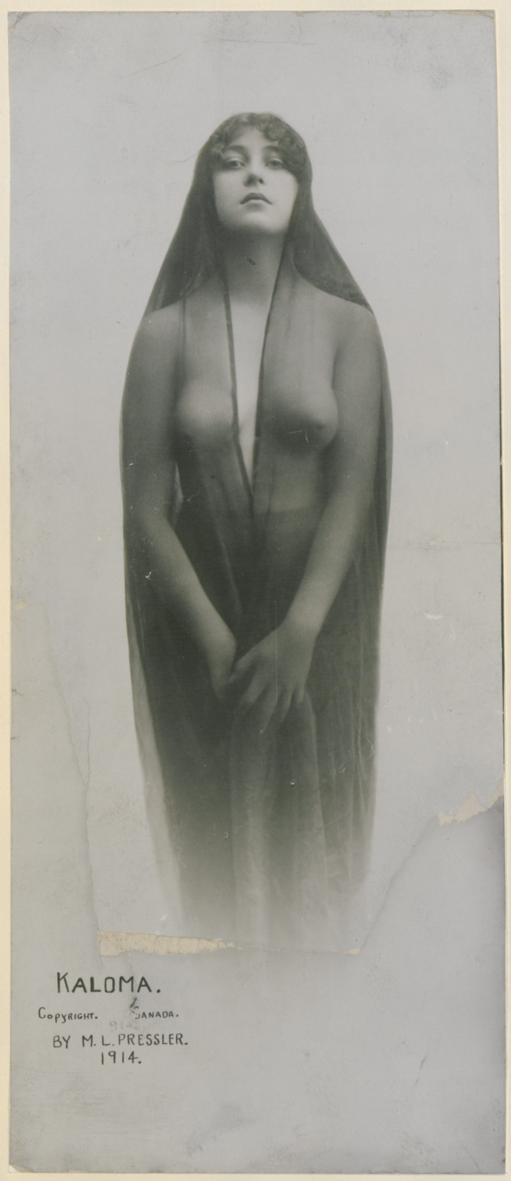 black and white image of Josephine Earp with see through robe