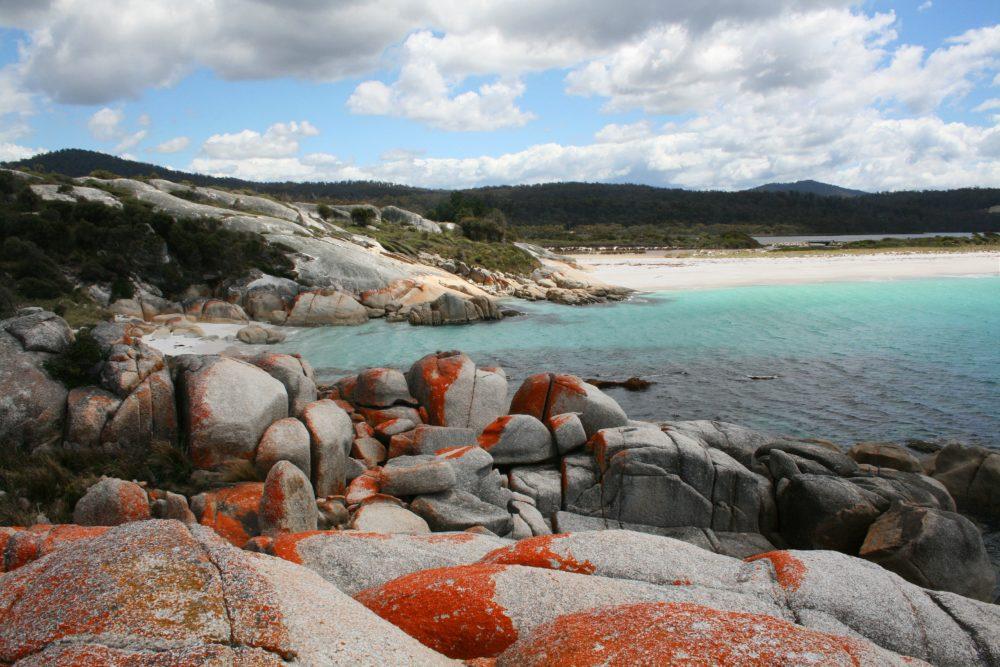 stunning view of sea through pebbles on beach in tasmania