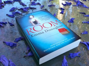 Room book by Emma Donoghue - on table with rose petals