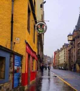 You'll know you're in the right place when you see the vibrant yellow Museum of Edinburgh building.