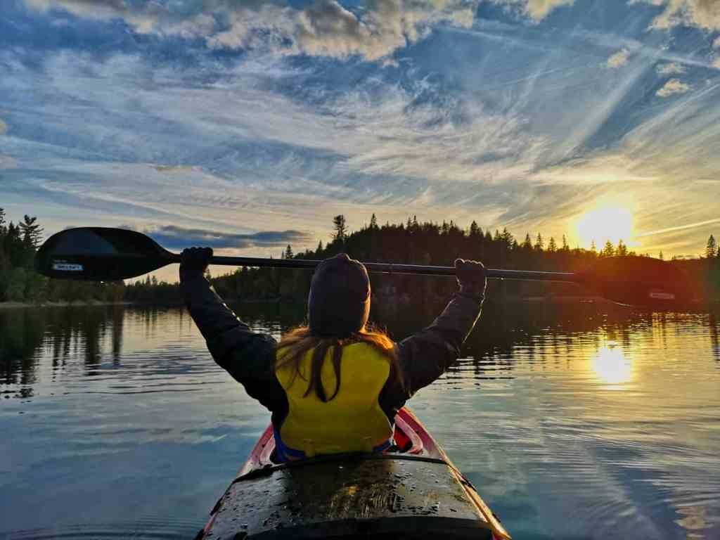 Amanda explores the world, sometimes via kayak, by using volunteer opportunities to help her save money.