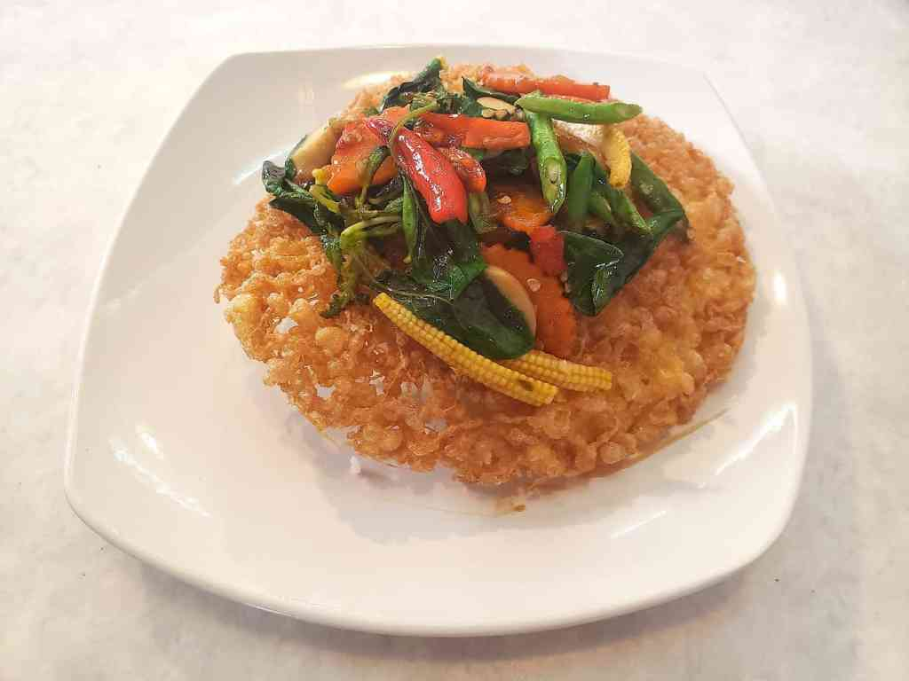 The delicious veggie, Pad Kra Praow that you'll find at Kopi Hya Tai Kee.
