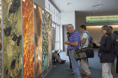 "The ""Where in the World"" game is an annual favorite among attendees. Individuals take their best guesses to figure out where on the Earth the poster sized aerial imagery represents."