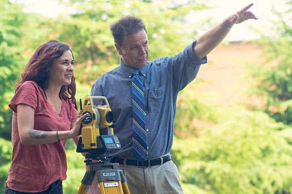 Student Logan Moore operates a total station surveyor with Dr. Jeff Turk, IESA director. Image: University of North Georgia.