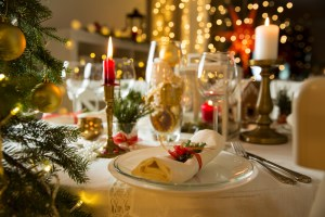 set and decorated table ready for holiday meal