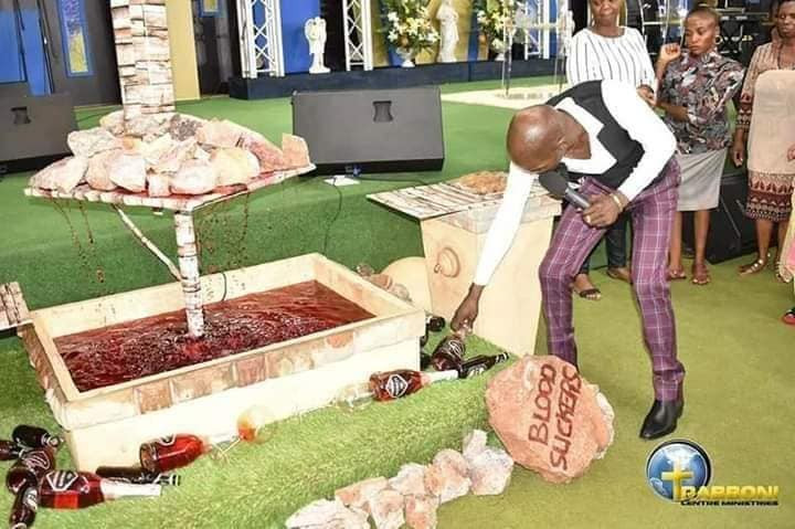 Pastor feeds his church members millipede and beer (photos) 3