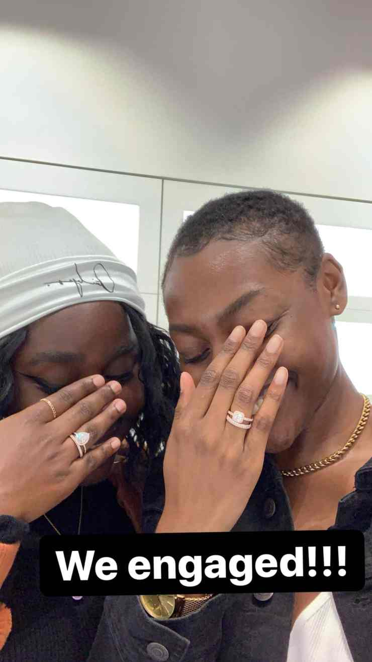 Two ladies show off their rings to announce their engagement to each other 2