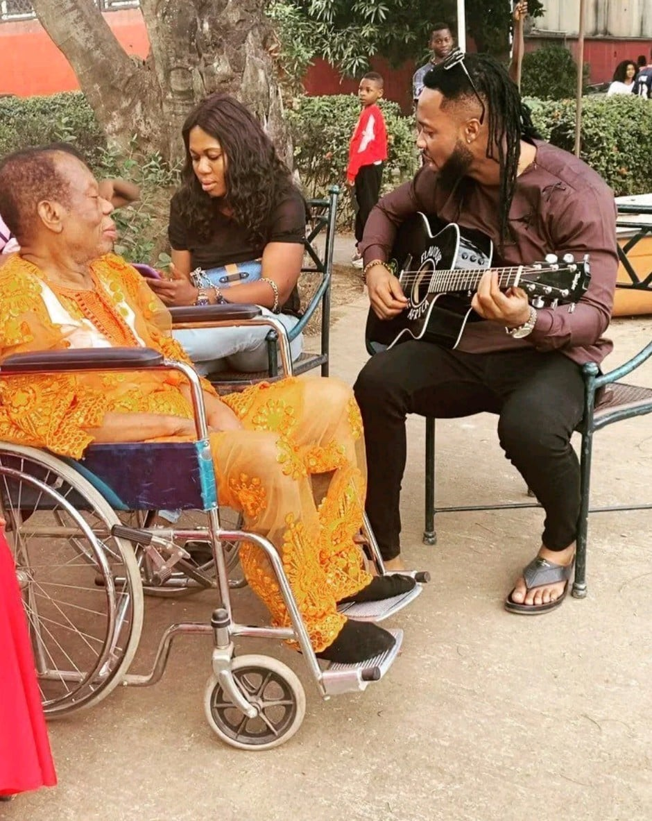 ENTERTAINMENT NEWS Adorable video of Singer, Flavour playing the guitar for his aged father in Enugu 2