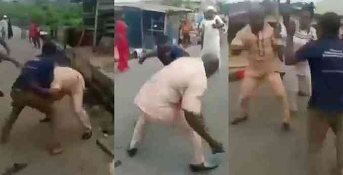 Two grown men fight over a woman in the middle of the road (Video)