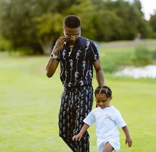 Wizkid steps with his son Zion