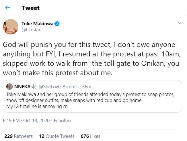 """""""God will punish you"""" – Toke Makinwa slams lady who said she went to #EndSARS protest to snap pictures"""