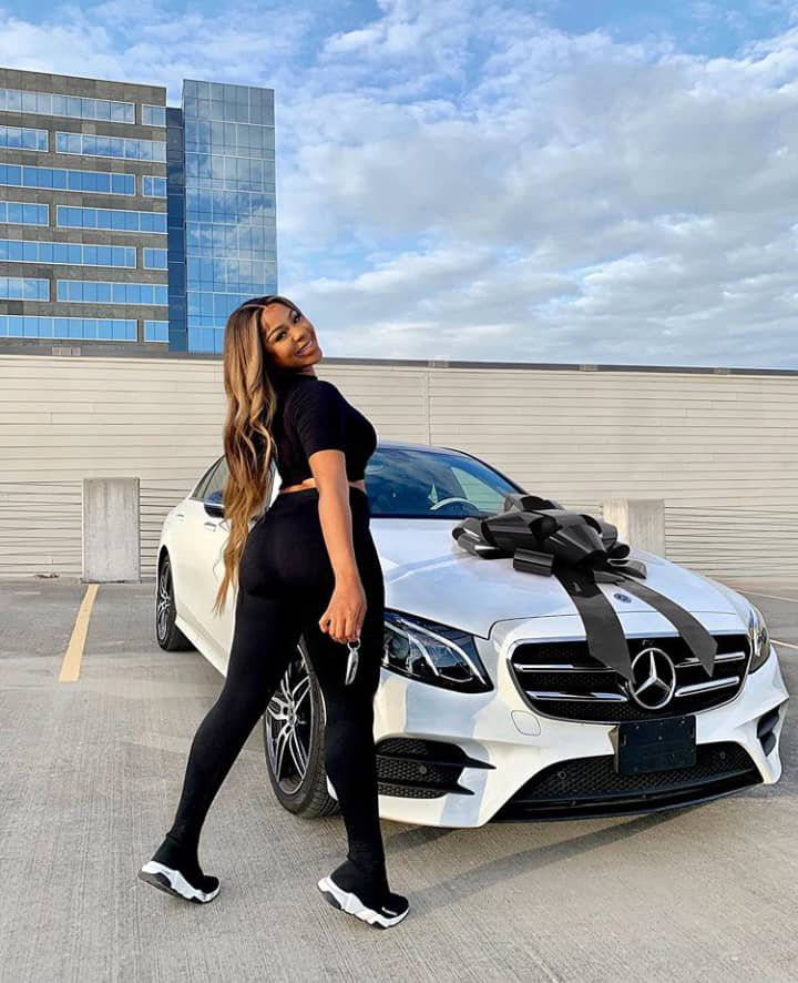"""Excited Nigerian lady unblocks all her """"haters"""" as she buys her dream car, 2020 Mercedes Benz E350 (Photos)"""