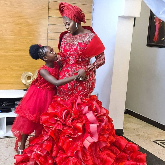 Mercy Johnson-Okojie and hubby dedicate their fourth child in church