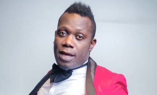 Duncan Mighty drags his wife