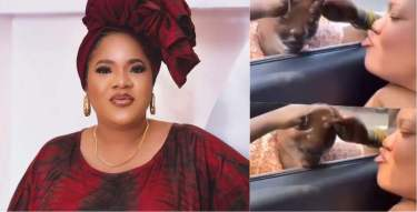 Reactions as Toyin Abraham blows child beggarkiss in traffic (Video)