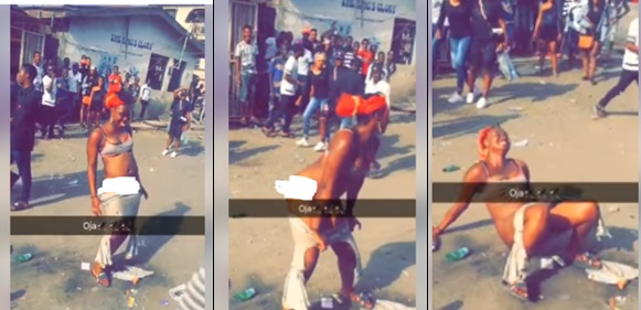 Lady strips off in the middle of a road in Mushin, Lagos (photos)