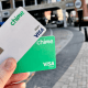 a person holding chime debit and credit card