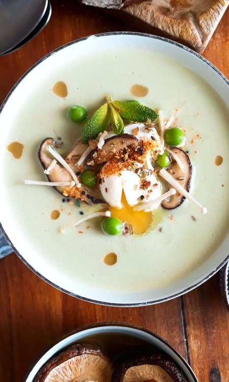 Pea and mint veloute with dashi bouillon and a poached quail's egg