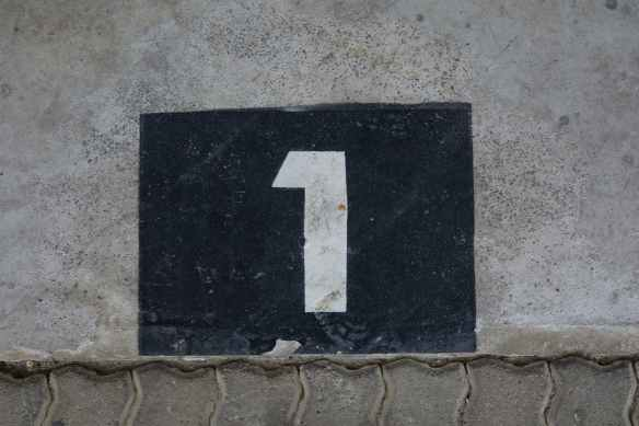 sign with house number on wall