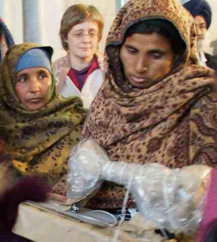 Widow receiving a sewing machine
