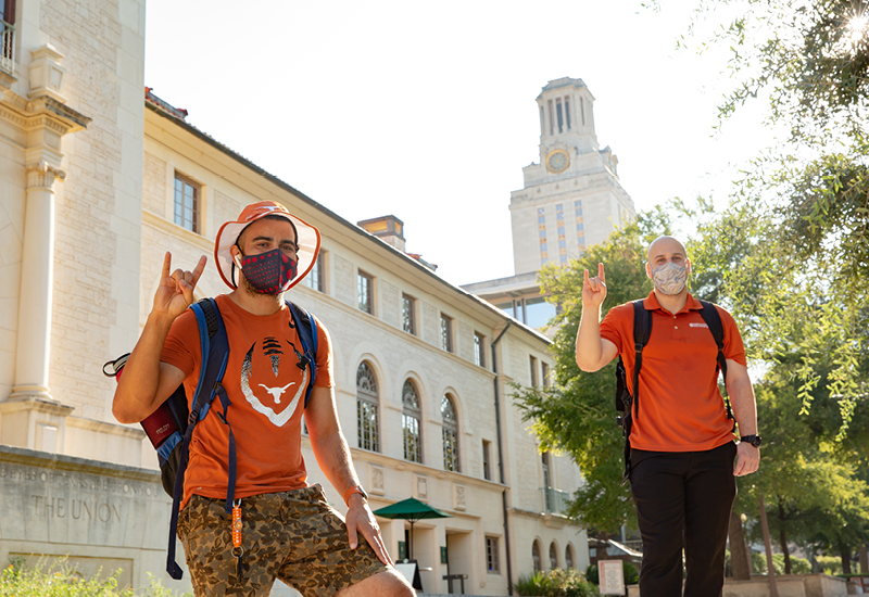 UT Students wearing masks in front of Tower