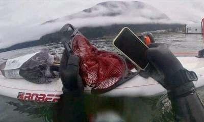 iPhone 11 under lake