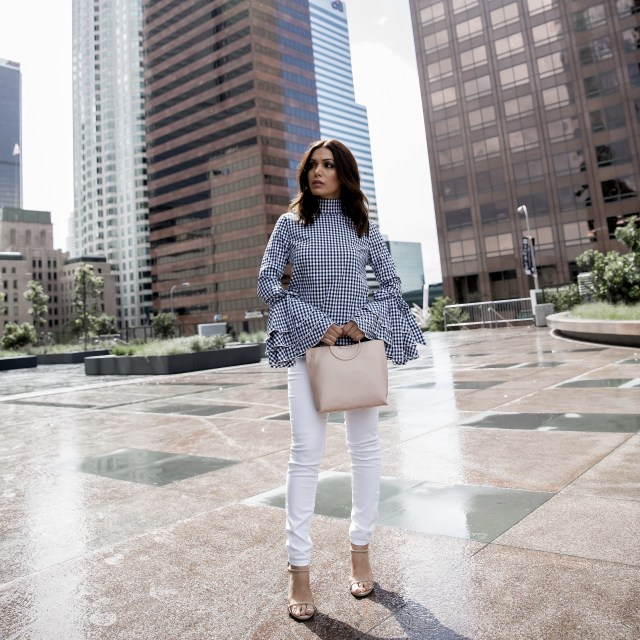 Fashion Blogger from Glam and Posh wearing gingham top and white pants for summer trend in downtown LA