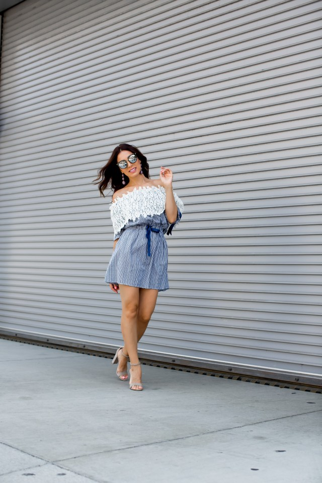 Fashion blogger wearing a off shoulder summer dress with statement earrings