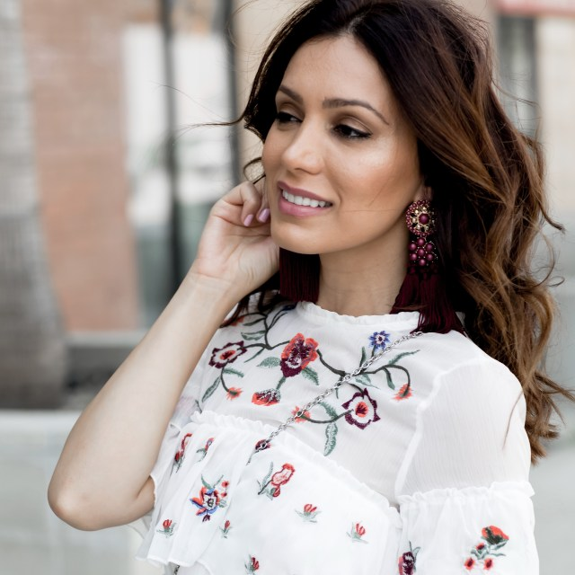 fashion blogger wearing a white coat for fall with a floral dress