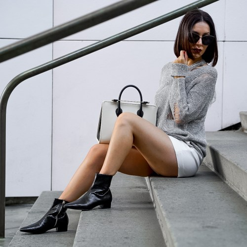 Fashion blogger wearing patent boots for Fall