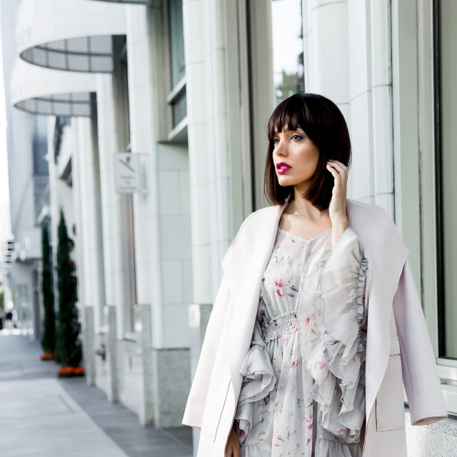 Fashion Blogger wearing pink blush suede coat over a ruffle dress