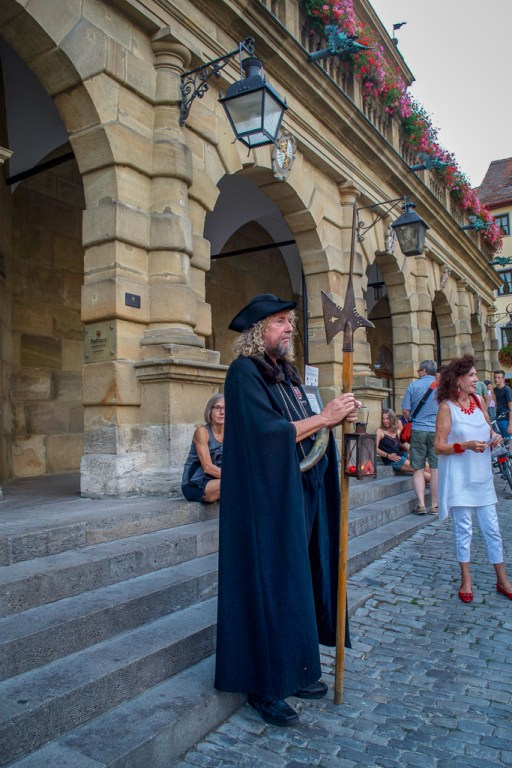 On Market Square's Town Hall steps, getting ready for the Rothenburg Night Watchman Tour