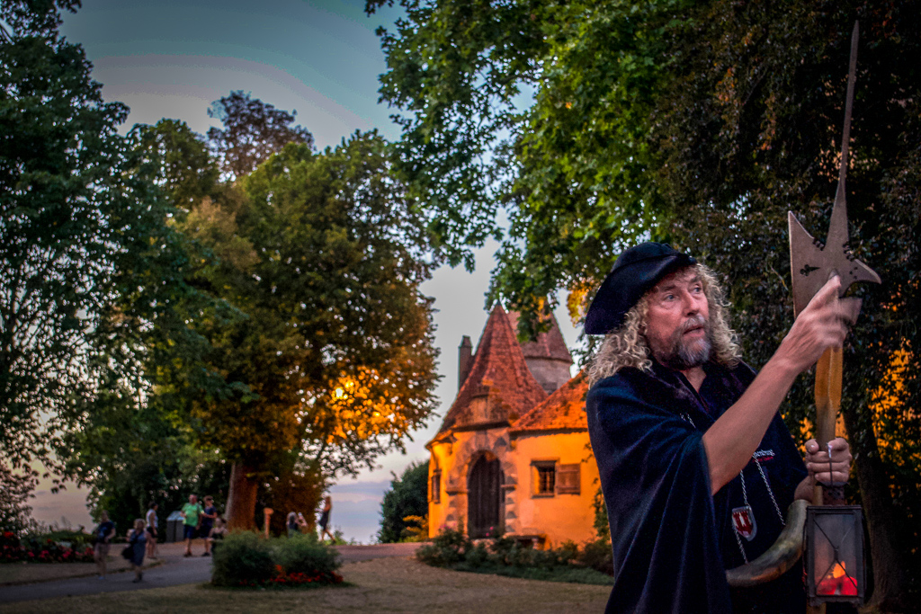 The Rothenburg Night Watchman tour guide, the Night Watchman, giving a mysterious speech