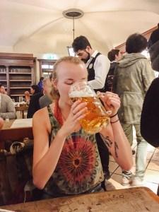 Woman drinking German beer stein at Hofbrauhaus Munich