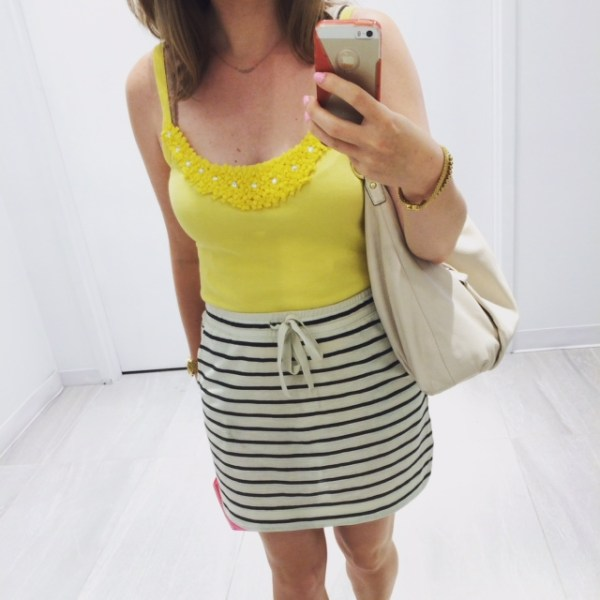 Yellow tank top and black and white skirt